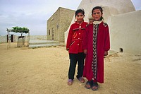 Syrian Bedouin girls in local dress in a typical Beehive village near Aleppo, Halab, Syria