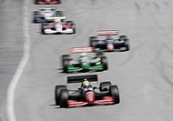 Formula race cars racing down track (blurred motion)