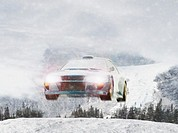 Rally Car Flying through Wintry Landscape