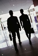 Silhouette of Businesspeople Walking in Lobby