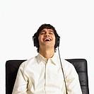 Man Closing Eyes and Enjoying Music