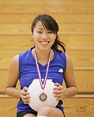 Portrait of Young Teenage Volleyball Player Sitting on Bleachers