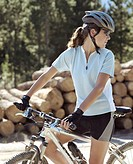 Young female cyclist looking over shoulder
