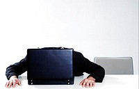 Businessman sleeping on an opened briefcase