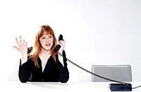 Businesswoman feeling irritated with a phone conversation
