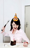 Woman trying to hammer her birthday cake