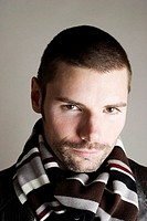 Man with scarf around his neck