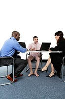 Businessman in boxer shorts having discussion with his business partners