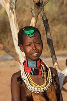 Girl Hamer tribe. Lower basin of Omo river. Copper skin with very fine features and wear metal arm and leg bracelets, shells and beads. South Ethiopia...