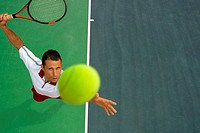 Top View of Male Tennis Player Mid-Serve