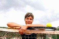 Female Tennis Player Leaning on Net