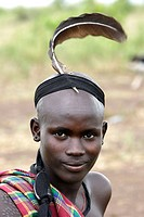 Mursi boy. Omo valley tribe. South Ethiopia.