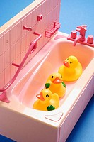 Rubber duckies in toy bathtub