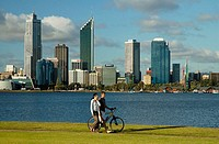 Couple walking along the banks of the Swan River in Perth. Australia. December 2005