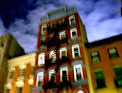 New York apartment buildings are captured at night with a blury, pastel effect