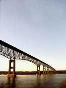 A bridge spanning the Hudson River is captured against a beautiful blue sky