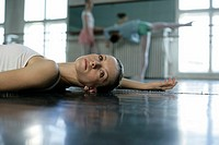A female ballet dancer lying on the floor