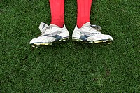 Football shoes on grass