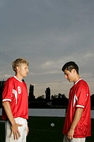 Two soccer players standing vis-&#224;-vis