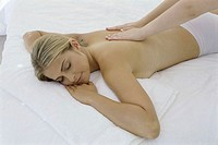 High angle view of a young woman getting a back massage (thumbnail)