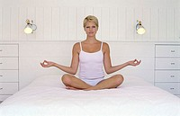 Portrait of a young woman sitting in a lotus position (thumbnail)