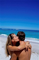 High angle view of a young couple embracing on the beach