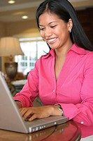 Close-up of a young woman using a laptop