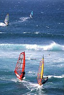 Windsurfers jumping waves, Hawaii, USA
