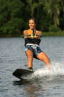 Young adult woman wakeboarding, Florida, USA
