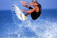 Mature adult man surfing