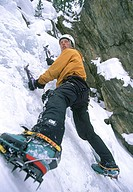Young adult man ice climbing, Utah, USA