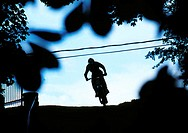 Silhouette of a person riding a bicycle