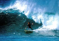 Mid adult man surfing in the sea (thumbnail)