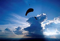 Silhouette of a person paragliding