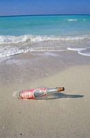 Bottle in the sand on the beach