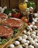 Raw meat with mushrooms and vegetables