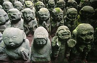 Small concrete figures covered with moss at Atago Nembutsu-ji, in Sagano. Kyoto city. Kyoto. Japan