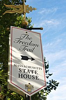 Massachusetts, Boston, Sign with arrowing pointing to Massachusetts State house, site along Freedom Trail