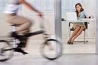 Woman working as man rides bike