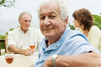 Senior adults drinking wine