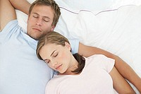 Mid adult couple sleeping