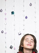 Portrait of a child with christmas decorations