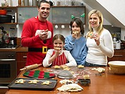 Family eating gingerbread men