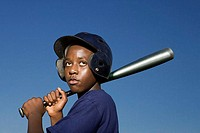 Teenage boy about to swing baseball bat