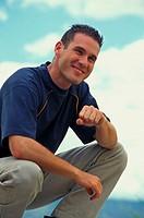 Young man smiling, close-up