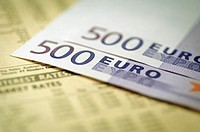 European currency: five hundred euro bank note on top of stock market report