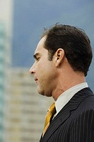 Close-up of a businessman standing outdoors
