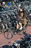 Cyclist at Central Station bike parking. Amsterdam, Holland