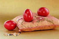 Red eggs on pink pillow