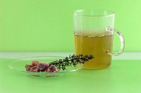 Glass with herbal tea, thyme and rock candy